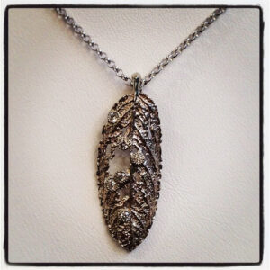 white gold and diamond leaf pendant
