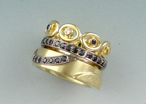 Black Diamond Rings in white and yellow gold