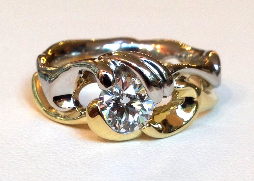 Two tone wave diamond engagement ring