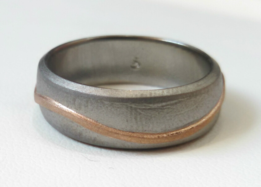 Designer stainless steel ring with rose gold inlay custom made