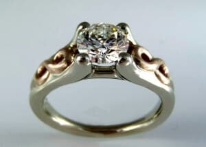 Custom designed rose gold infinity engagement ring with white gold and diamond