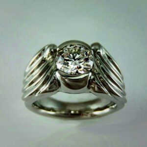 Carved white gold winged engagement ring setting with diamond