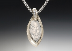 Carved Moonstone Cirque Leaf Pendant