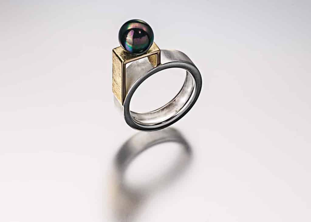 Sterling silver, 18k, cultured black pearl ring.