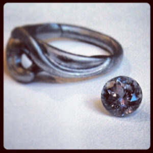 purple-grey sapphire stone ready for setting