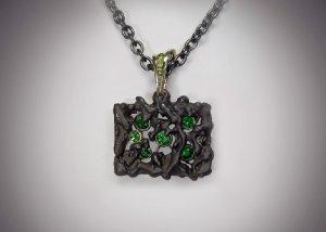 steel and tsavorite garnet pendant