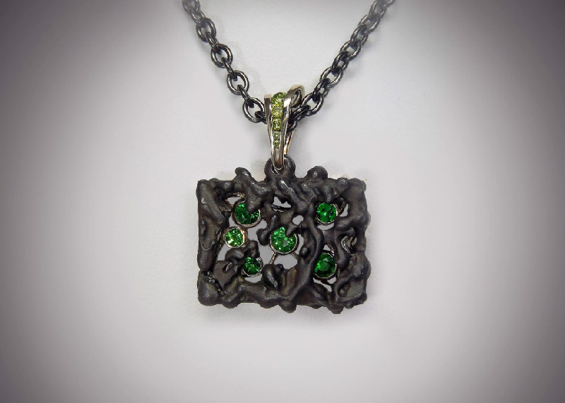 steel and tsavorite garnet pendant