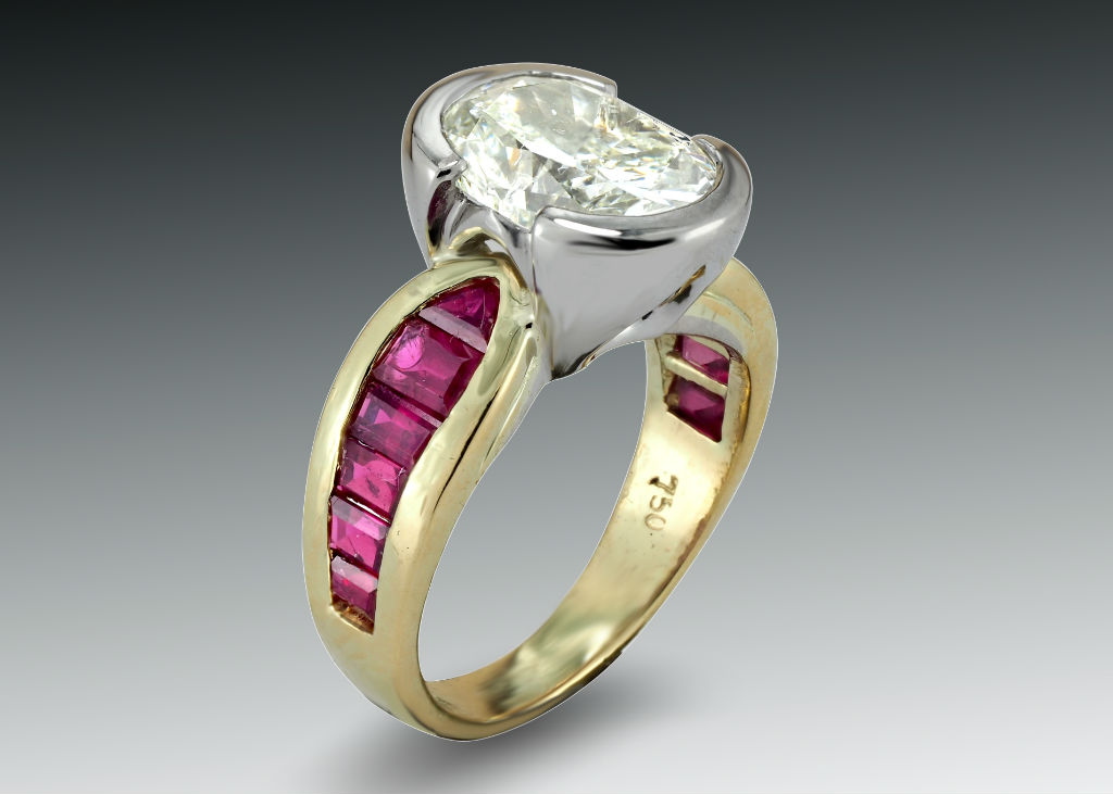 Oval diamond and ruby bimetal ring
