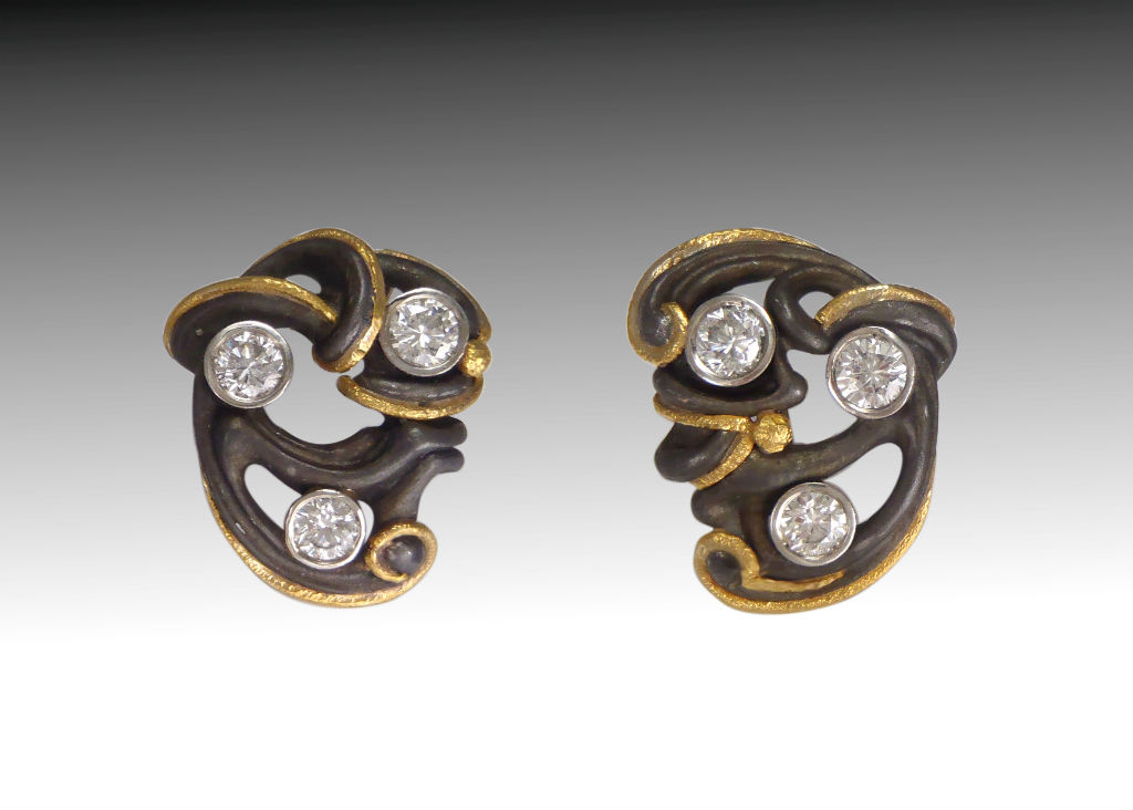 steel and 24 carat bean earrings with diamonds